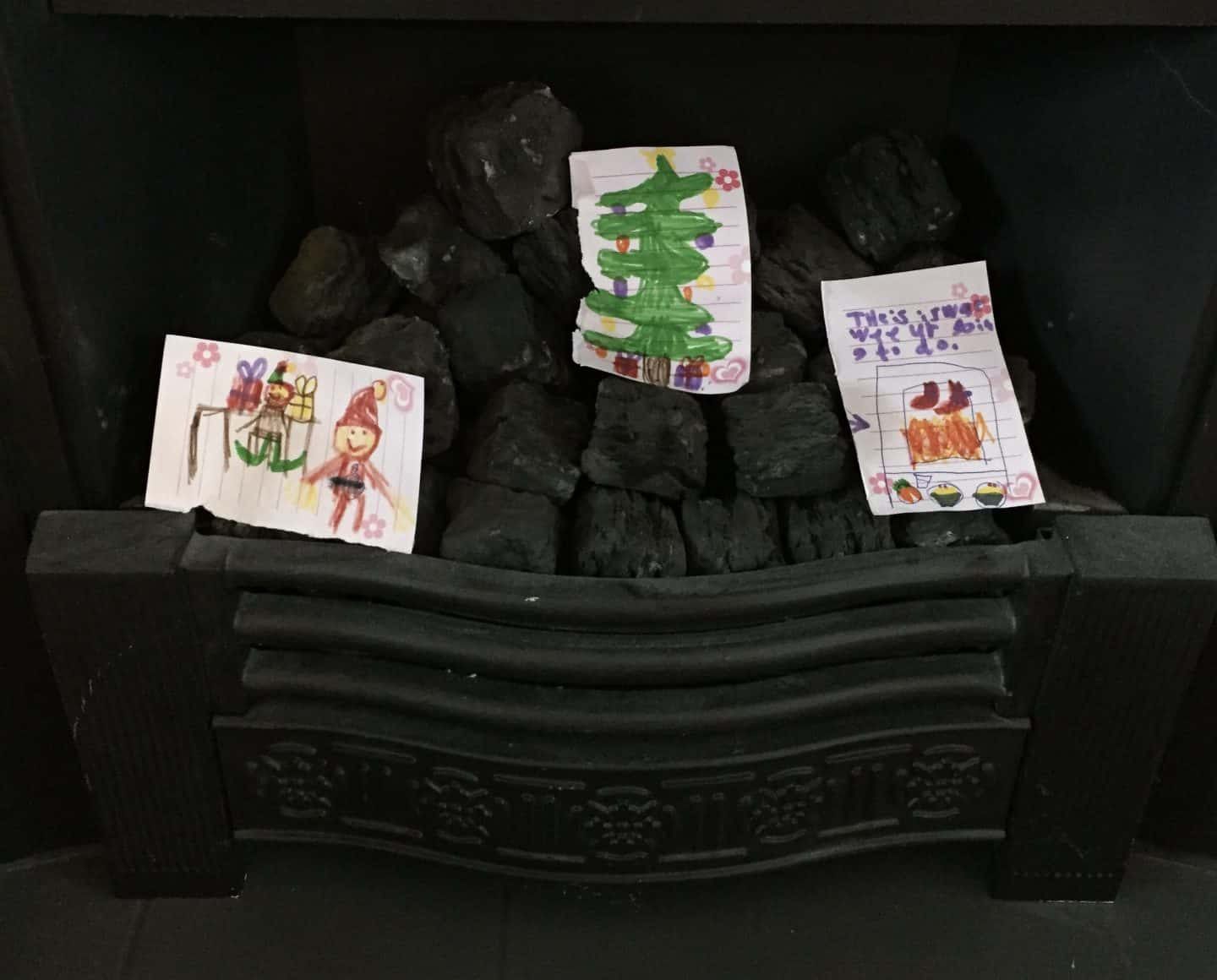 Christmas letters to Santa in the fireplace