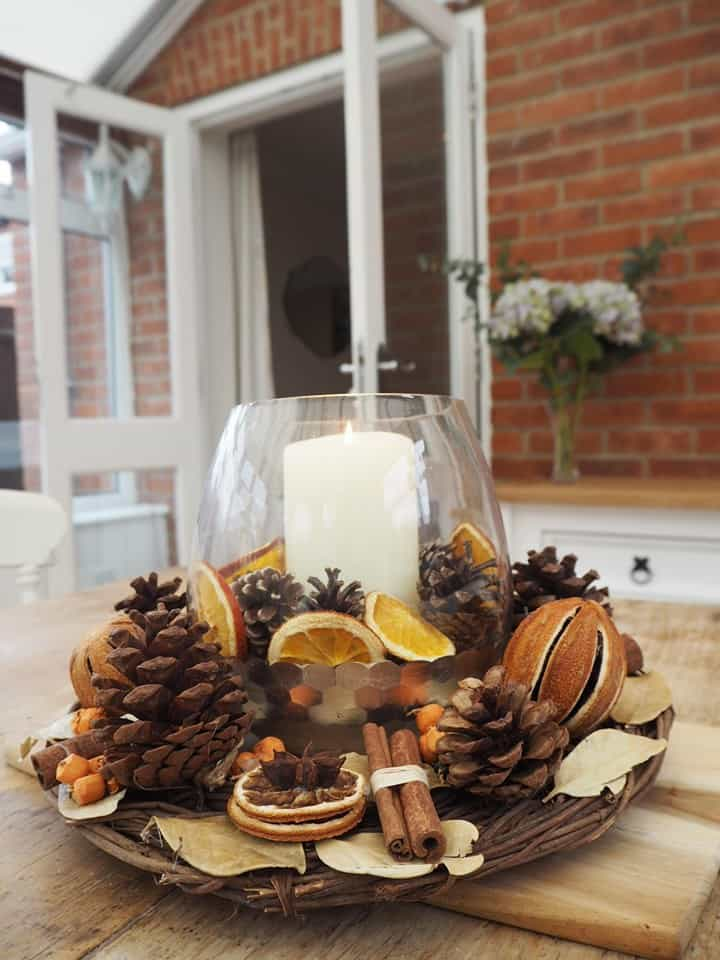 Christmas table centrepiece with dried oranges and cinnamon