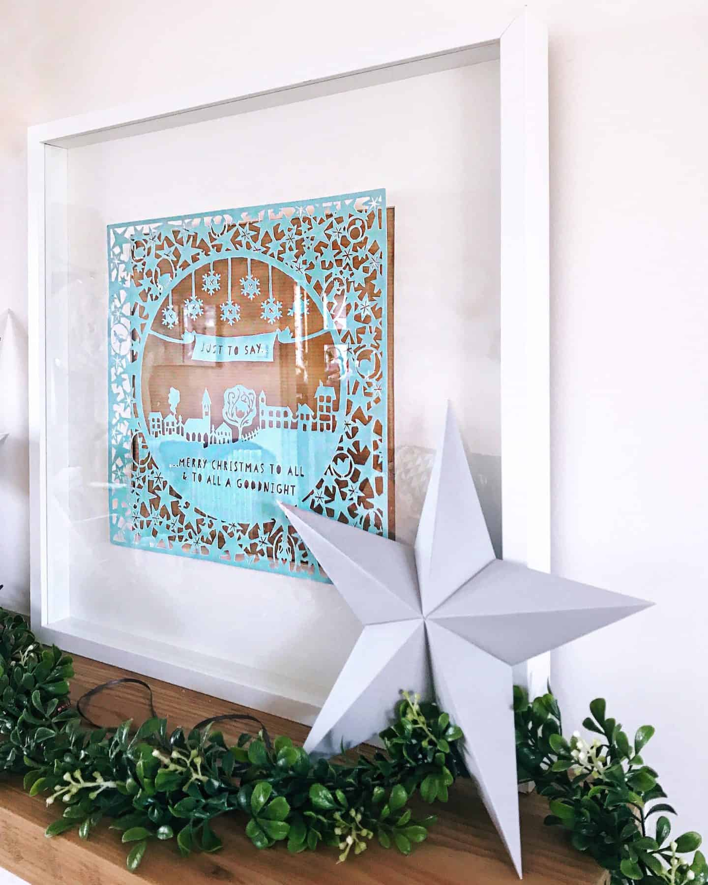 Origami star and Christmas Papercut