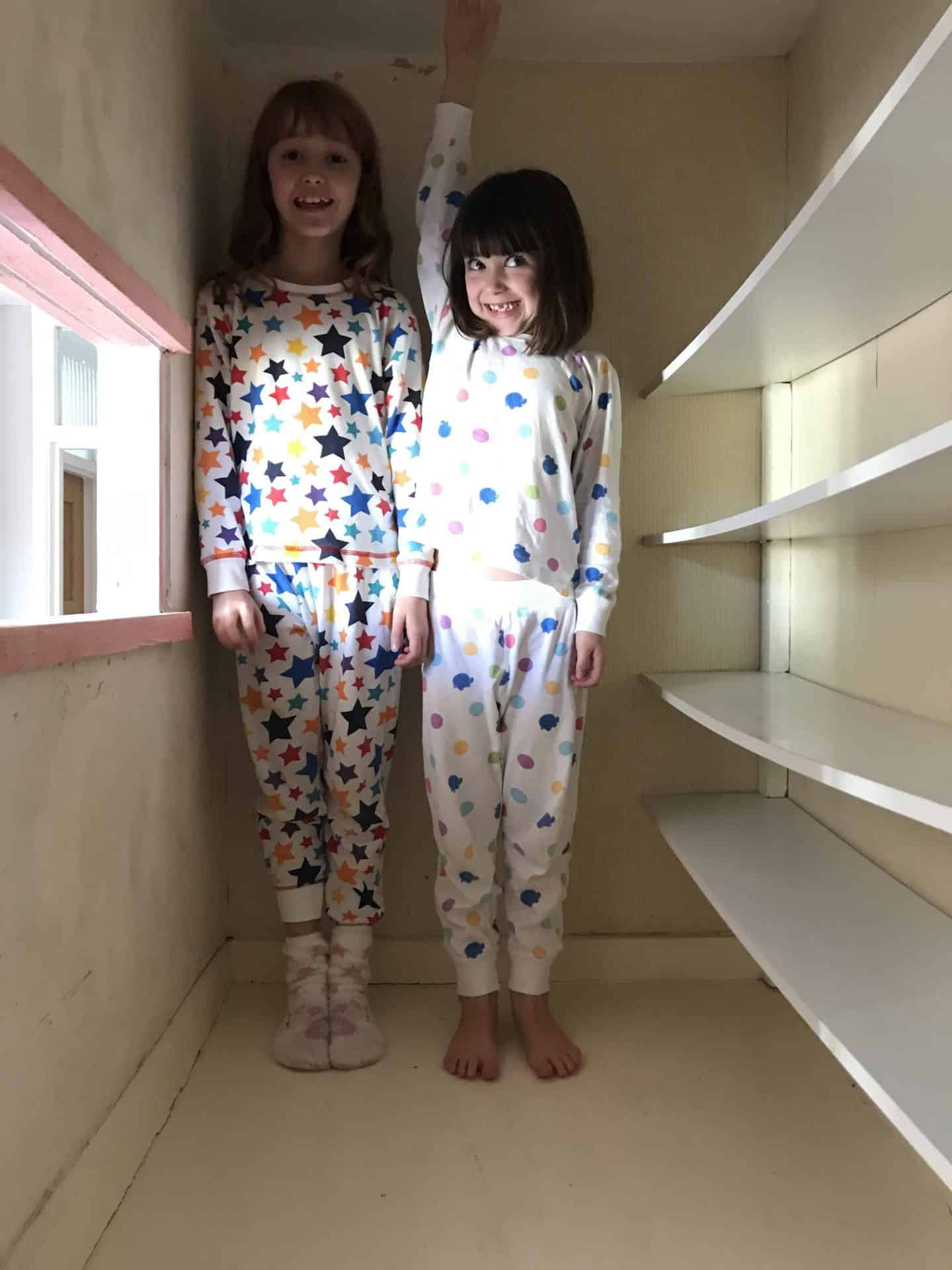 Kids standing in the cupboard above our stairs