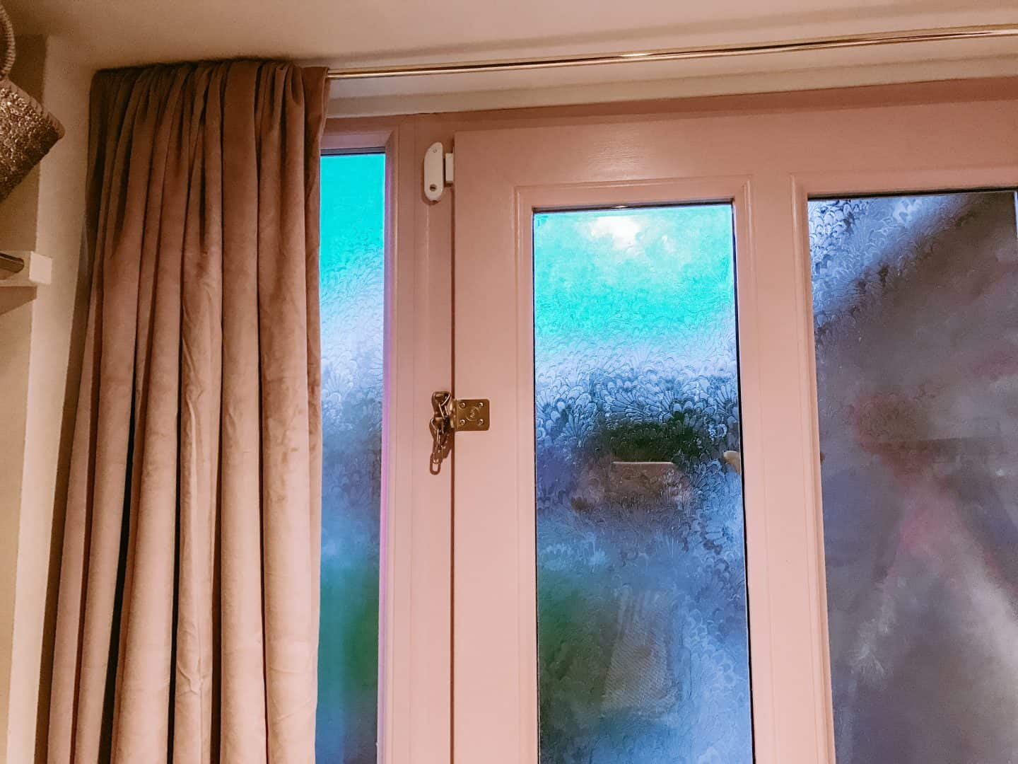Make a draughty hallway more cosy with a velvet curtain