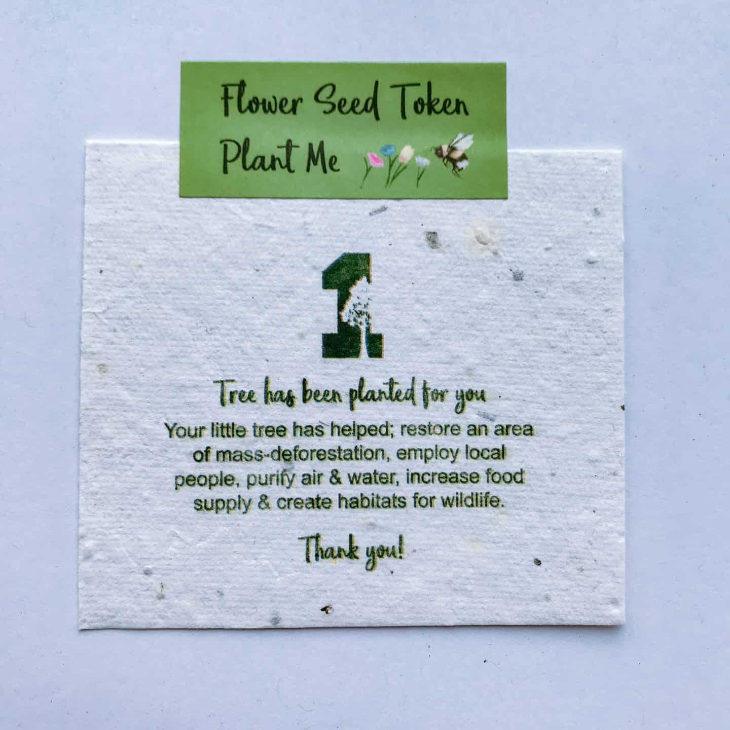 Seed token from a 1 Tree Cards eco friendly Christmas card