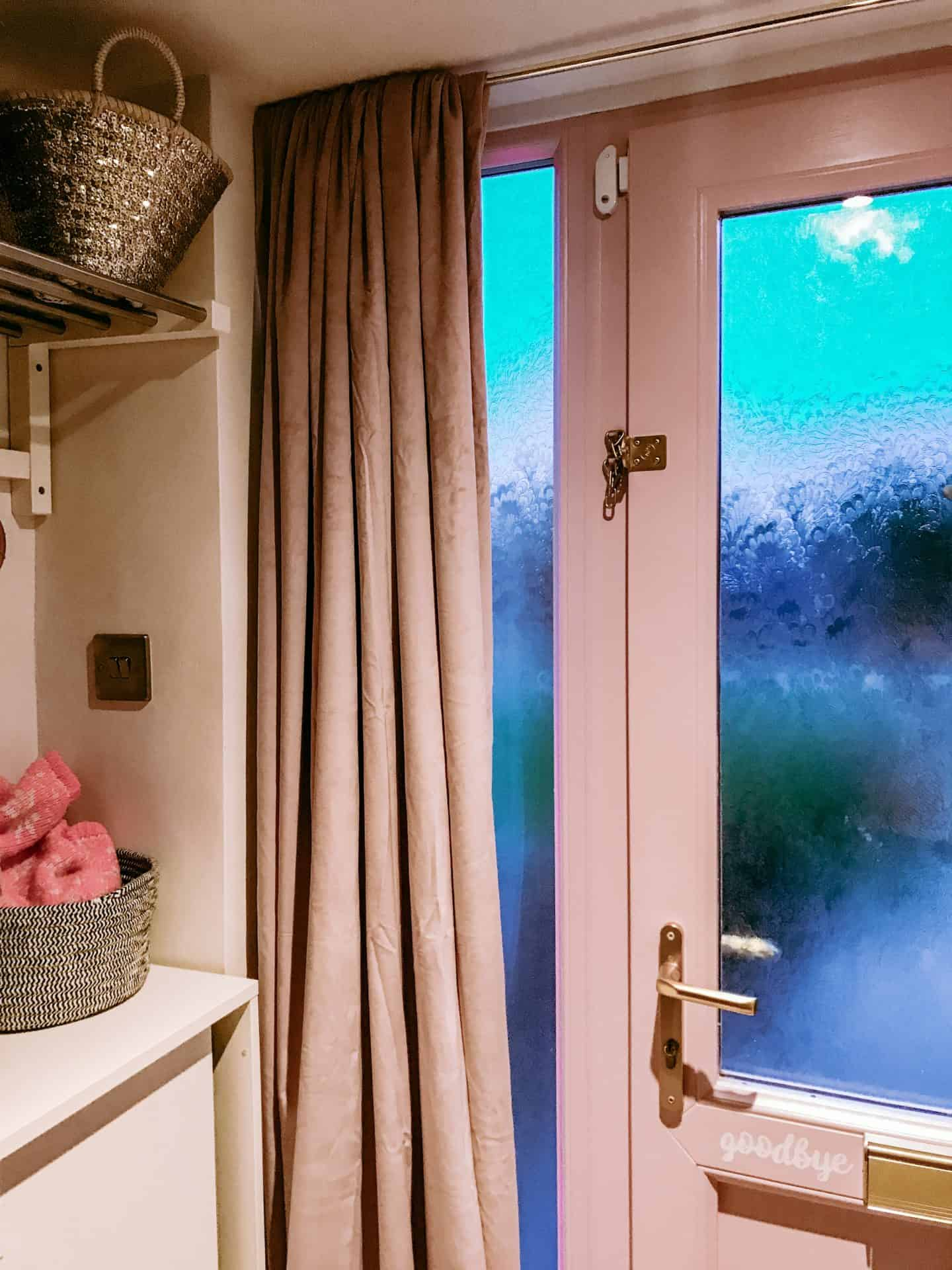 Use a velvet curtain behind your door to block draughts and make your home more cosy