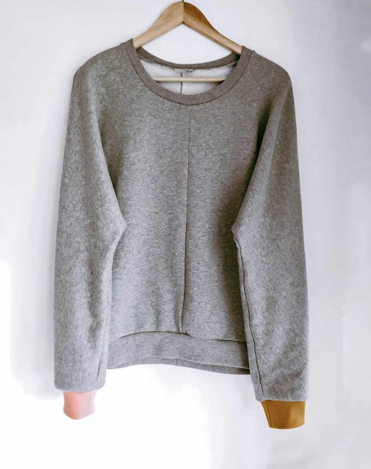 With Narrative organic grey marl sweatshirt with pink and mustard yellow cuffs