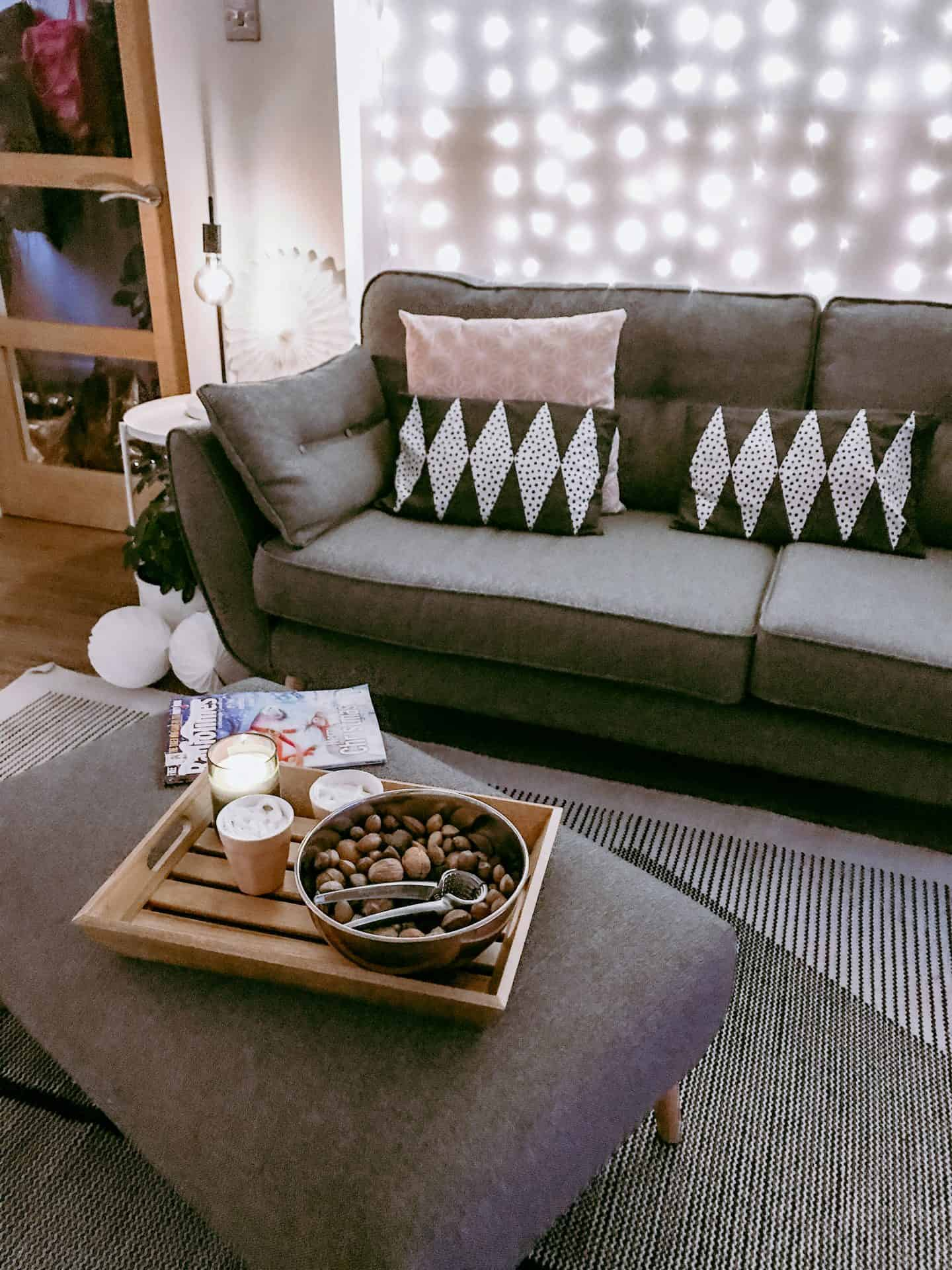 Christmas tray in front of a grey sofa
