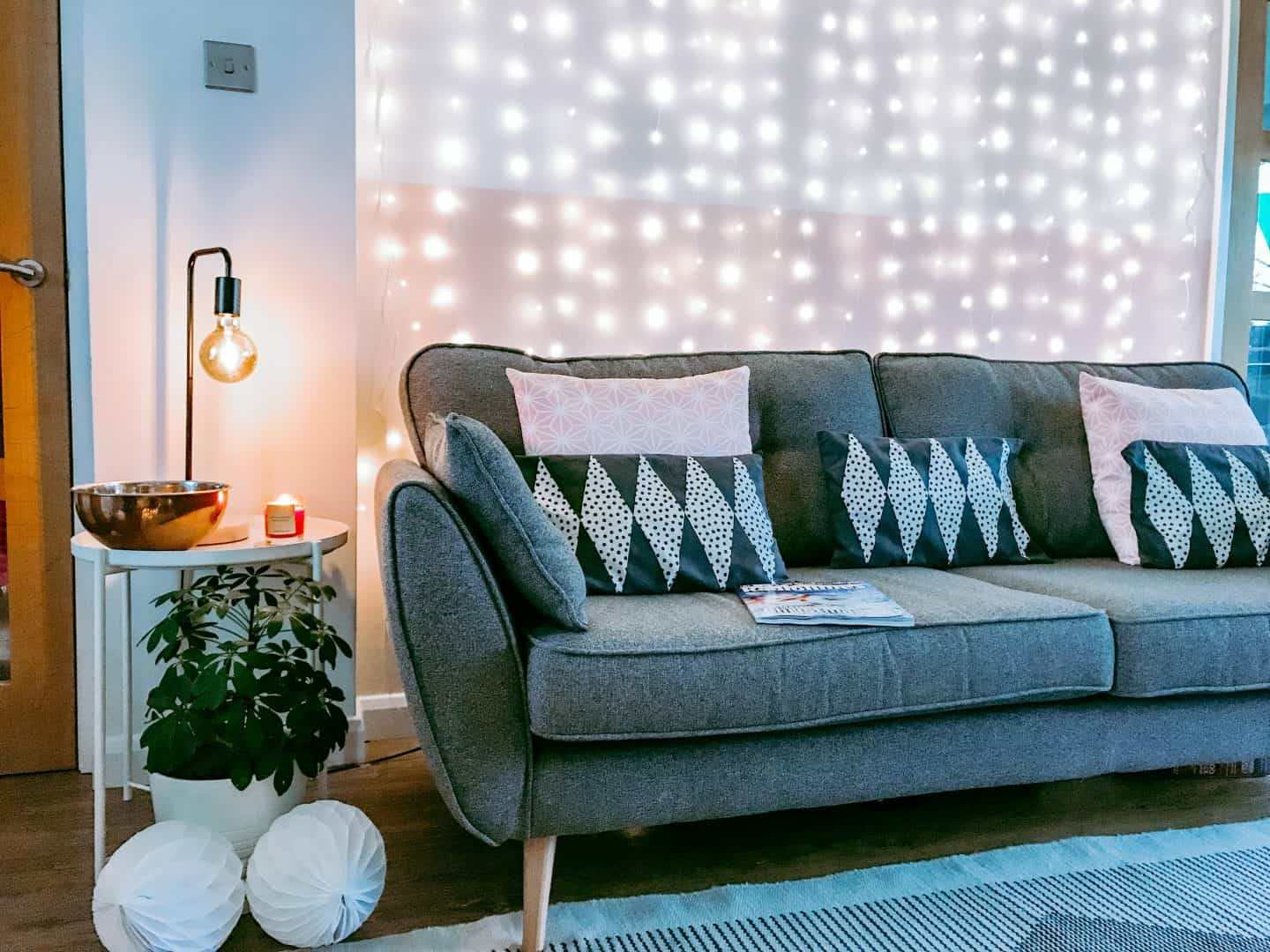 Grey sofa in front of LED curtain lights