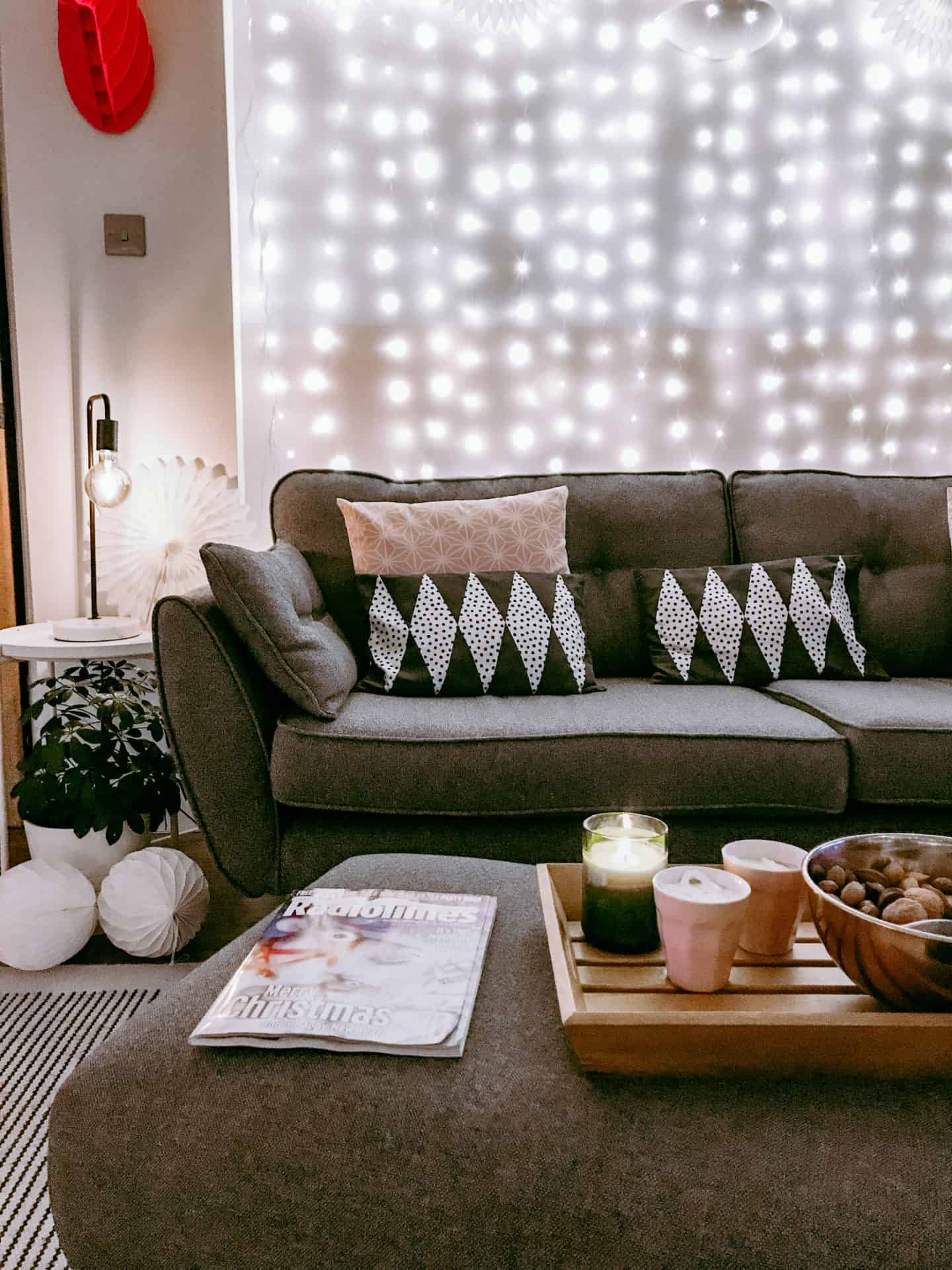 Hygge lounge with hot chocolate and a bowl of nuts and the Christmas Radio TImes