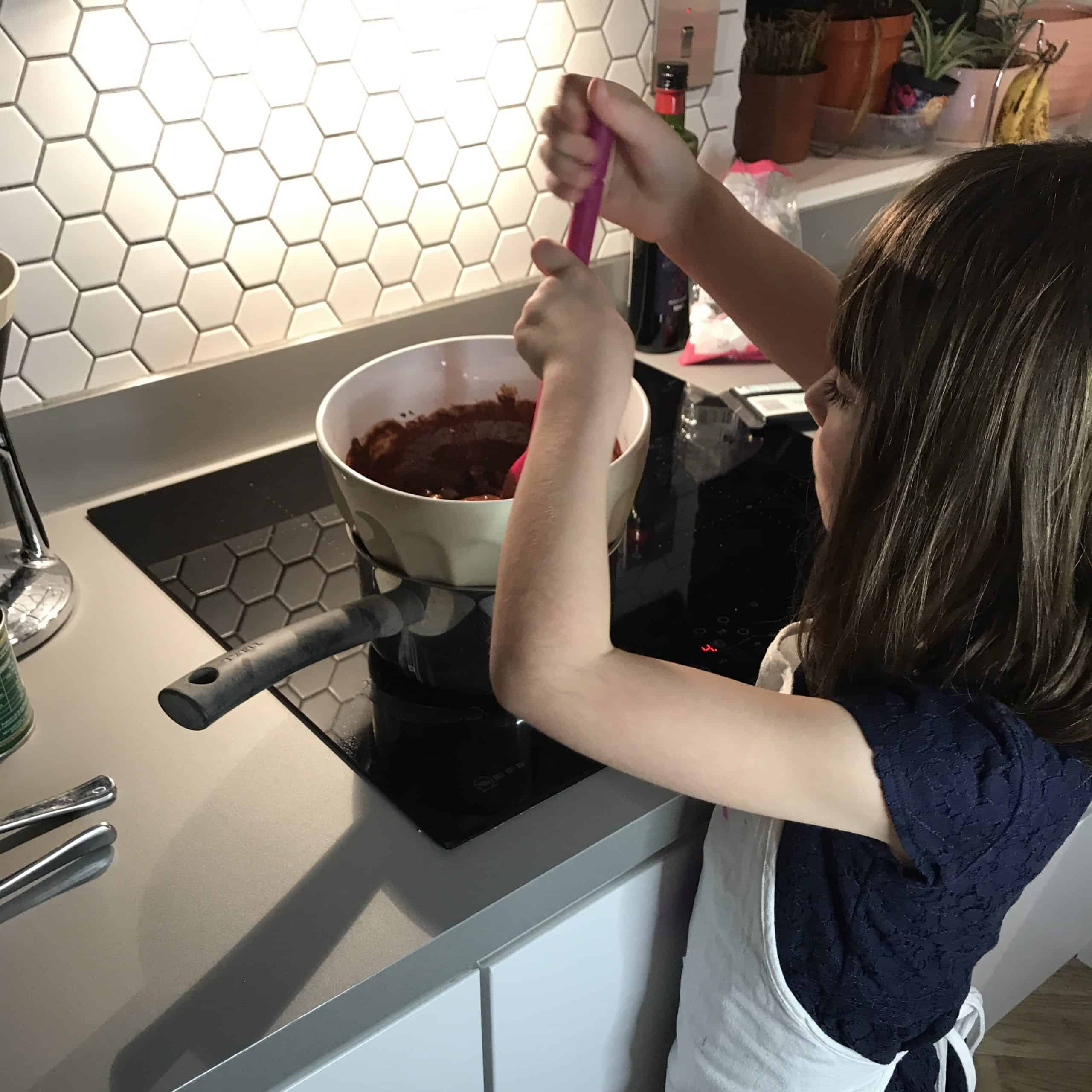 Stirring the chocolate mixture over a bain marie