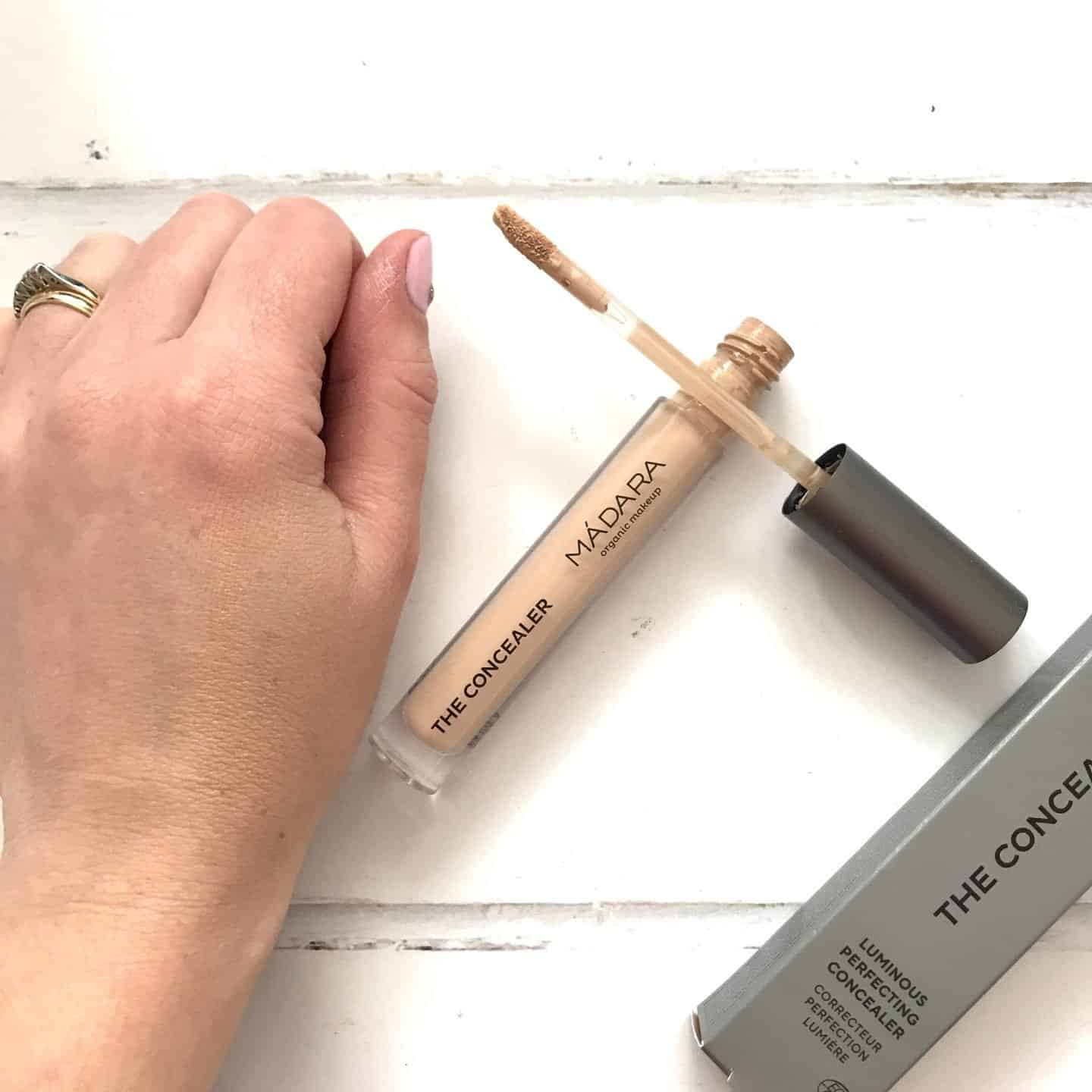 Madara The Concealer Luminous Perfecting Concealer swatch on hand blended in
