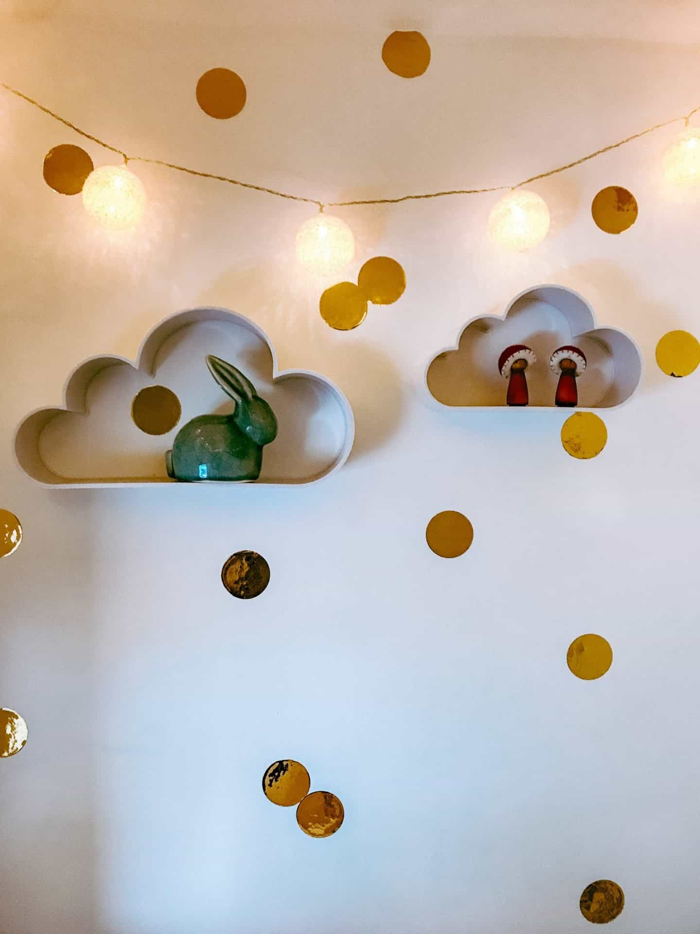 Cloud shelves, gold confetti wall stickers and fairy lights