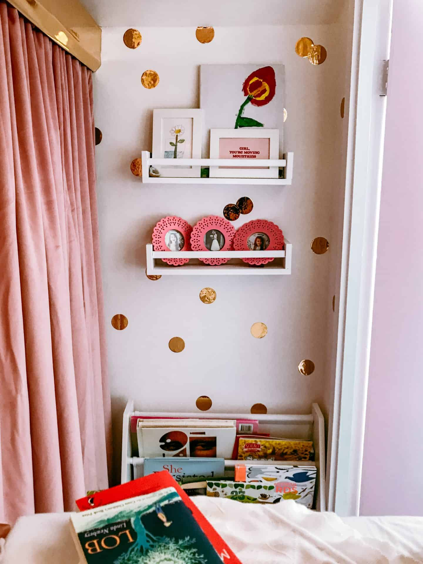 Inside a built in wardrobe converted into a magical kids' reading nook