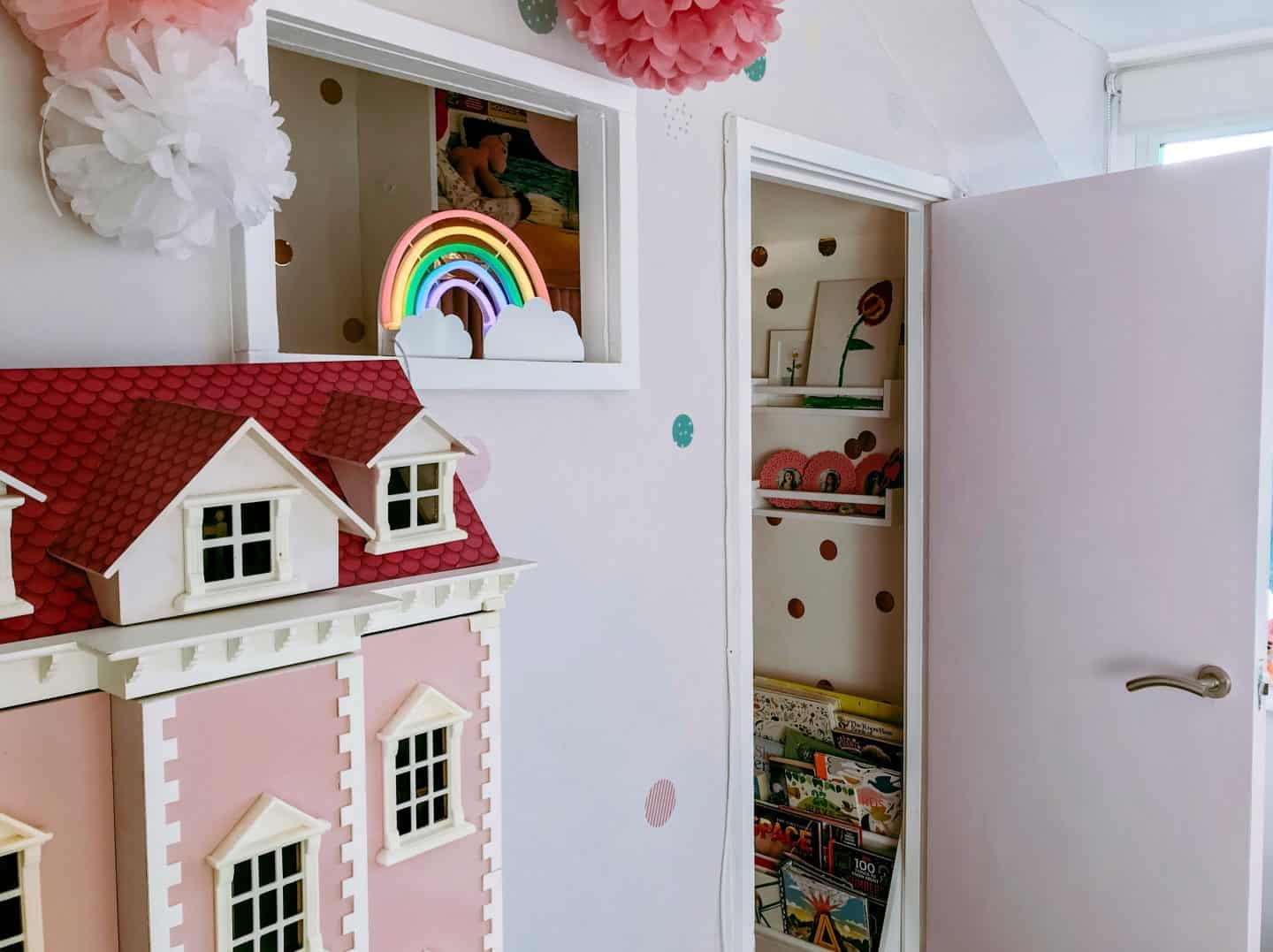 Kids den with an internal window made out of a cupboard