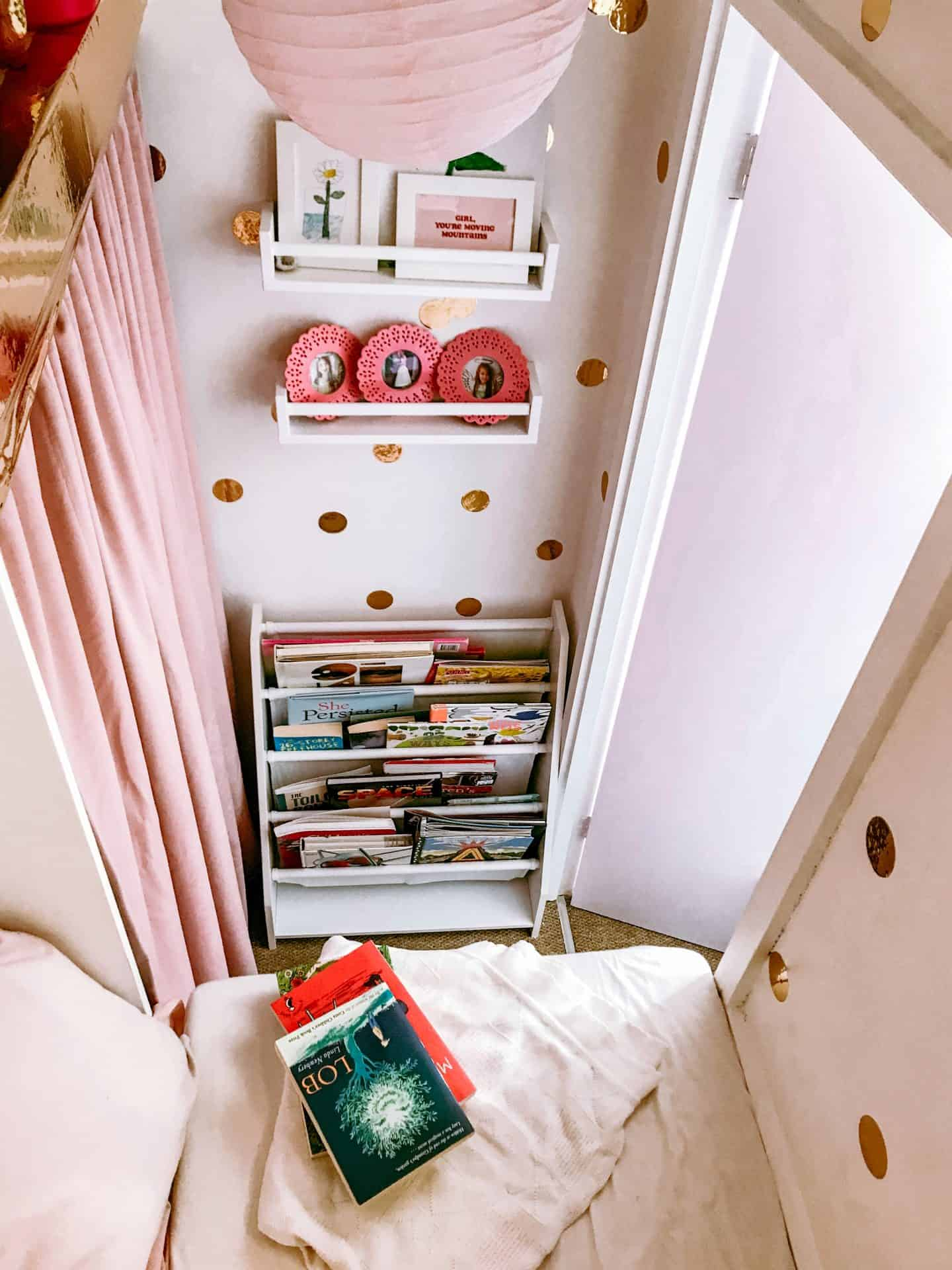 Looking down on the built in wardrobe converted into a magical kids' den and reading nook